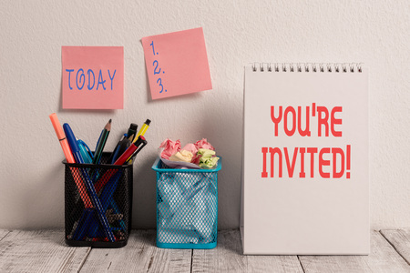 Conceptual hand writing showing You Re Invited. Concept meaning make a polite friendly request to someone go somewhere