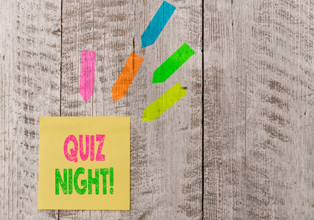 Conceptual hand writing showing Quiz Night. Concept meaning evening test knowledge competition between individuals Note paper and line arrow stickers on the top of wooden table desk Reklamní fotografie