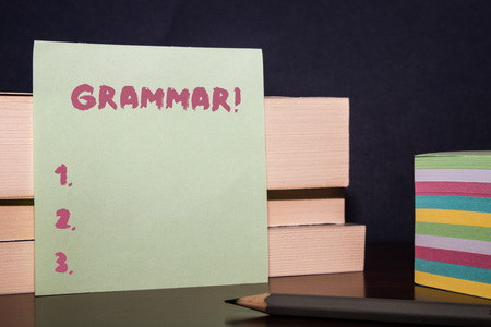 Conceptual hand writing showing Grammar. Concept meaning whole system structure language syntax and morphology Close up three wooden rectangle boxes paper pencil stack Stockfoto