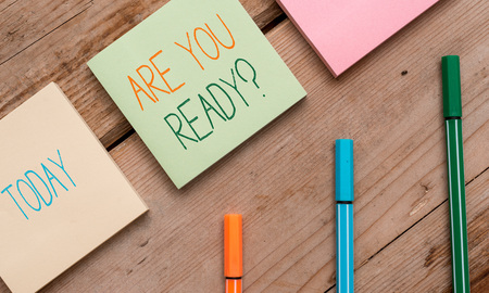 Text sign showing Are You Ready Question. Business photo showcasing used telling someone start something when feel prepared Note papers and stationary placed sideways on top of softhued backdrop