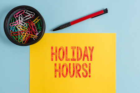 Text sign showing Holiday Hours. Business photo text Overtime work on for employees under flexible work schedules Stock Photo