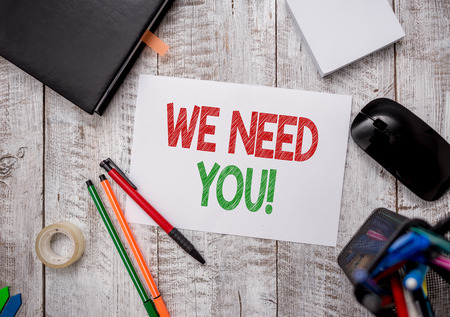 Writing note showing We Need You. Business concept for asking someone to work together for certain job or target Stationary and computer stuff pen with paper sheets on desk Stock fotó