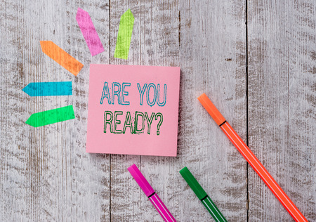 Text sign showing Are You Ready Question. Business photo text used telling someone start something when feel prepared Plain note paper and line arrow stickers on the top of wooden table desk