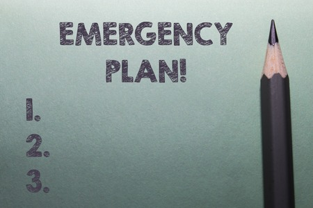 Writing note showing Emergency Plan. Business concept for actions developed to mitigate damage of potential events Close up front view pencil lying on stationary sheet paper Writing