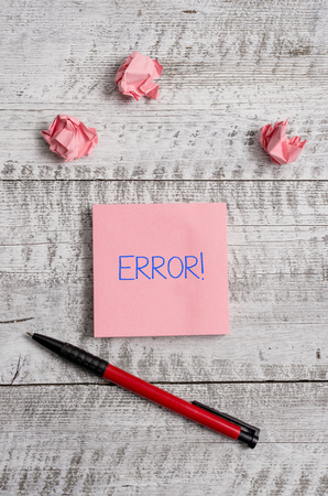 Conceptual hand writing showing Error. Concept meaning state or condition of being wrong in conduct judgement or program Stationary and paper scraps with sheets on the wooden desk