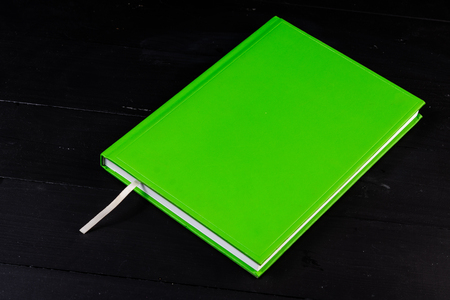 Front view closed colored notebook bookmark. Writing down ideas. Background