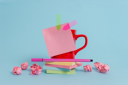 Coffee cup pen note banners stacked pads paper balls pastel background