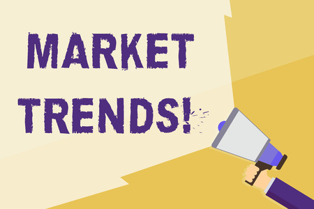 Writing note showing Market Trends. Business concept for Changes and developments in buying and selling in the market Hand Holding Megaphone with Wide Beam Extending the Volume