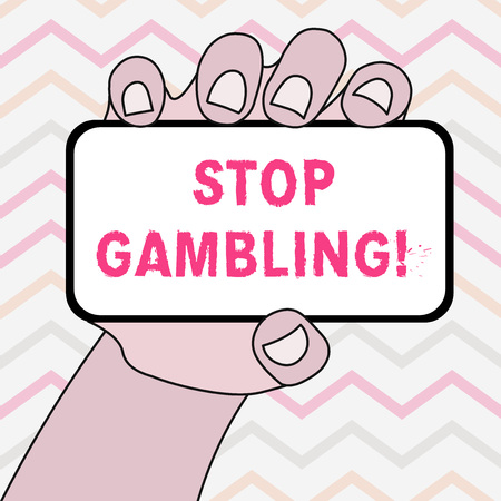 Text sign showing Stop Gambling. Business photo showcasing stop the urge to gamble continuously despite harmful costs Closeup of Smartphone Device Held in Hand with Blank Screen and Text Space