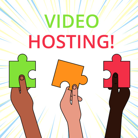 Conceptual hand writing showing Video Hosting. Concept meaning Enables users to upload and play back video content on the net Three Colored Jigsaw Puzzle Pieces in Different People Hands Stockfoto