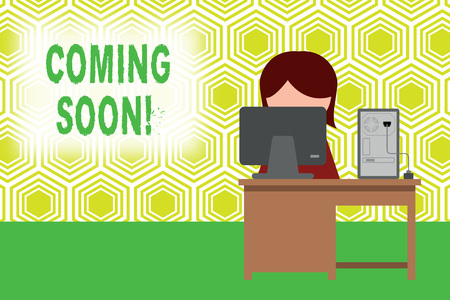 Text sign showing Coming Soon. Business photo showcasing event or action that will happen after really short time Young female working office sitting desktop computer office monitor photo 免版税图像