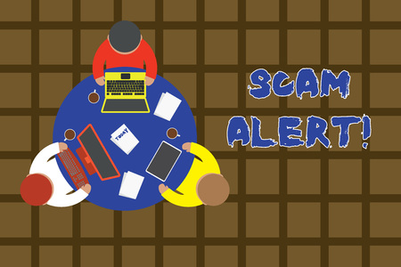 Word writing text Scam Alert. Business photo showcasing fraudulently obtain money from victim by persuading him Working round table male employees electronic devices documents coffee cup