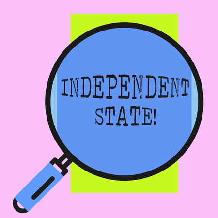 Conceptual hand writing showing Independent State. Concept meaning ability of the state to be independent and have autonomy Round magnifying glass with iron handle frame to look bigger