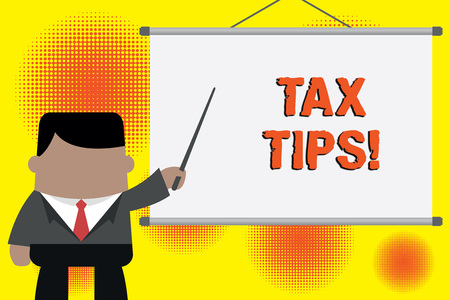 Handwriting text writing Tax Tips. Conceptual photo compulsory contribution to state revenue levied by government Businessman standing in front projector screen pointing project idea