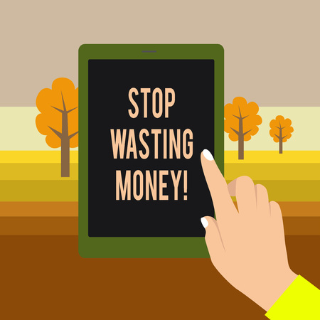 Text sign showing Stop Wasting Money. Business photo showcasing advicing demonstrating or group to start saving and use it wisely Female Hand with White Polished Nails Pointing Finger Tablet Screen Off