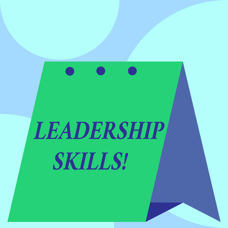 Text sign showing Leadership Skills. Business photo showcasing Skills and qualities that leaders possess Taking a lead Open big standing calendar Desk monthly planner Geometrical background Stock Photo
