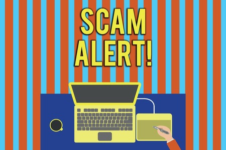Handwriting text Scam Alert. Conceptual photo fraudulently obtain money from victim by persuading him Upper view laptop wooden desk worker drawing tablet coffee cup office