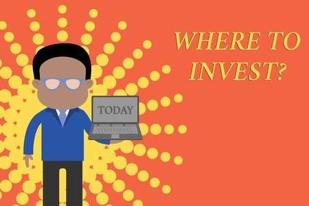 Writing note showing Where To Invest question. Business concept for asking about actions or process of making more money Standing man in suit wearing eyeglasses holding open laptop photo Art