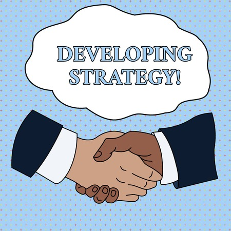 Word writing text Developing Strategy. Business photo showcasing Organizations Process Changes to reach Objectives Hand Shake Multiracial Male Business Partners Colleagues Formal Shirt Suit