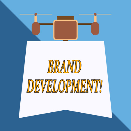 Writing note showing Brand Development. Business concept for Defining the product to excel in the market Promoting Drone holding downwards banner. Geometrical abstract background design