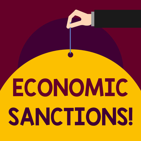 Writing note showing Economic Sanctions. Business concept for Penalty Punishment levied on another country Trade war Man hand hold big paper tie string thumb and index finger