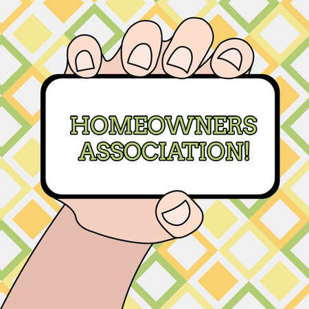 Writing note showing Homeowners Association. Business concept for Organization with fee for upkeeps of Gated Community Closeup of Smartphone in Hand with Blank Screen and Text Space