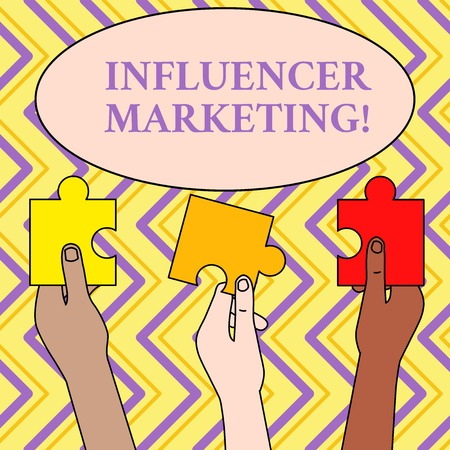 Writing note showing Influence Marketing. Business concept for Endorser who Influence Potential Target Customers Three Colored Empty Jigsaw Puzzle Pieces Held in Different People Hands