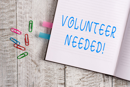 Text sign showing Volunteer Needed. Business photo text asking demonstrating to work for organization without being paid Thick pages notebook stationary placed above classic look wooden backdrop
