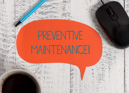 Writing note showing Preventive Maintenance. Business concept for Avoid Breakdown done while machine still working Wooden vintage table background coffee cup speech bubble