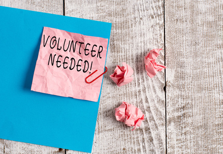 Writing note showing Volunteer Needed. Business concept for asking demonstrating to work for organization without being paid Wrinkle paper and cardboard placed above wooden background