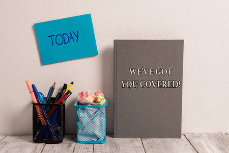 Handwriting text We Ve Got You Covered. Conceptual photo have done gotten or provided whatever needed Empty Sticky Card on Wall Two Mesh Pencil Pots Grey Hardcover Notebook