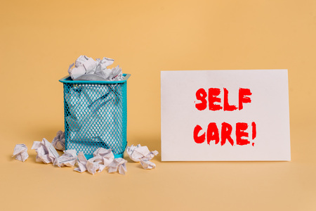 Handwriting text Self Care. Conceptual photo practice of taking action preserve or improve ones own health crumpled paper trash and stationary with empty paper placed in trash can