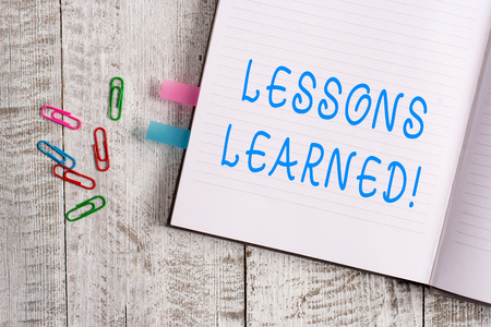 Text sign showing Lessons Learned. Business photo text experiences distilled project that should actively taken Thick pages notebook stationary placed above classic look wooden backdrop