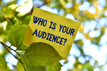 Word writing text Who Is Your Audience Question. Business photo showcasing who is watching or listening to it Piece of square paper use to give notation on tree leaf under sunny day