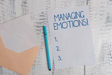 Conceptual hand writing showing Managing Emotions. Concept meaning ability be open to feelings and modulate them in oneself Colored envelope blank sheet ballpoint wooden background