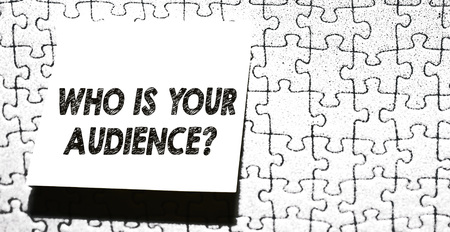 Word writing text Who Is Your Audience Question. Business photo showcasing who is watching or listening to it Piece of square note paper use for give notation stick to puzzle background