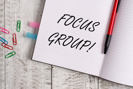 Conceptual hand writing showing Focus Group. Concept meaning showing assembled to participate in discussion about product Notebook stationary placed above classic wooden backdrop