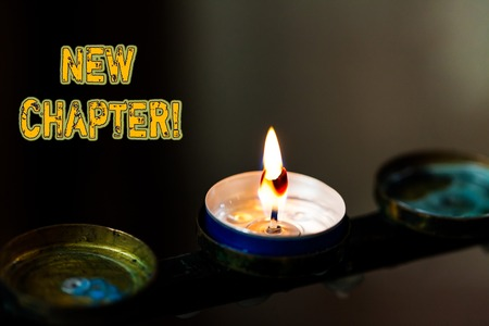 Text sign showing New Chapter. Business photo showcasing Starting ultimately something goals created in your mind Abstract burning candle set of three just one shining flame glowing dark Stok Fotoğraf