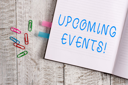 Text sign showing Upcoming Events. Business photo text thing that will happens or takes place soon planned occasion Thick pages notebook stationary placed above classic look wooden backdrop Stock Photo