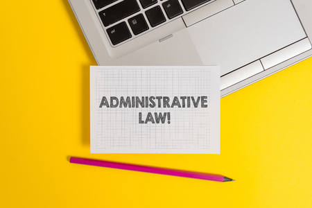 Handwriting text writing Administrative Law. Conceptual photo Body of Rules regulations Orders created by a government Top trendy metallic laptop pencil squared paper sheet colored background