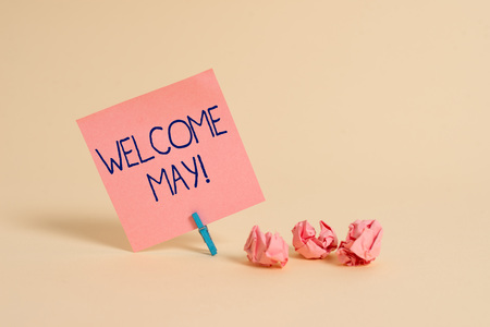 Handwriting text Welcome May. Conceptual photo welcoming fifth month of year usually considered summer Plain note paper and stationary placed above soft pastel colour backdrop