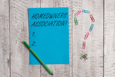 Handwriting text Homeowners Association. Conceptual photo Organization with fee for upkeeps of Gated Community Pastel colour note paper placed next to stationary above the wooden table Stock Photo - 124380046