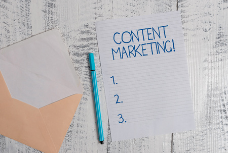 Conceptual hand writing showing Content Marketing. Concept meaning Involves the creation and sharing of online material Colored envelope blank sheet ballpoint wooden background Imagens