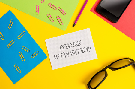 Text sign showing Process Optimization. Business photo text Improve Organizations Efficiency Maximize Throughput Paper sheets pencil clips smartphone eyeglasses notebook color background Stock Photo