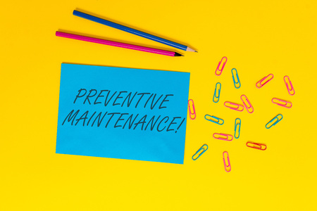 Writing note showing Preventive Maintenance. Business concept for Avoid Breakdown done while machine still working Blank paper sheet message reminder pencils clips colored background