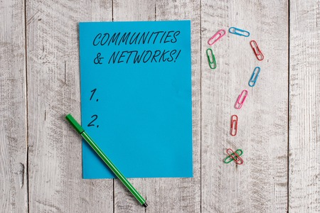 Handwriting text Communities And Networks. Conceptual photo Collaboration of Learnings and Practices of Members Pastel colour note paper placed next to stationary above the wooden table