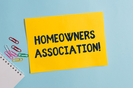 Text sign showing Homeowners Association. Business photo showcasing Organization with fee for upkeeps of Gated Community Plain cardboard and writing equipment placed above pastel colour backdrop