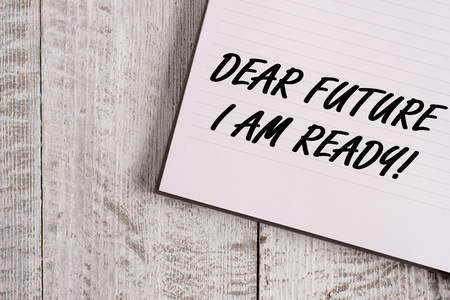 Conceptual hand writing showing Dear Future I Am Ready. Concept meaning state action situation being fully prepared Notebook stationary placed above classic wooden backdrop Stock Photo
