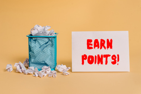 Handwriting text Earn Points. Conceptual photo collecting big scores in order qualify to win big prize crumpled paper trash and stationary with empty paper placed in trash can