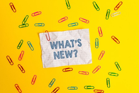 Text sign showing What S New Question. Business photo showcasing Asking about latest Updates Trends Happening News Blank crushed paper sheet message clips binders plain colored background